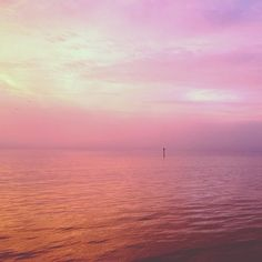 Sunrise in Charleston, South Carolina: pink sky reflected in the harbor on December 19, 2012.