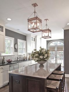 Grey kitchen walls & island, black countertops, white cabinets (not sure about copper light fixtures) Grey Kitchen Walls, White Kitchen Cabinets, Kitchen Paint, Kitchen Colors, New Kitchen, Kitchen Decor, Dark Cabinets, Kitchen Ideas, Design Kitchen