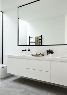Black and White Bathroom Design . Black and White Bathroom Design . A Contrasting Black and White Bathroom Echoes the Floor Laundry In Bathroom, Bathroom Faucets, Bathroom Wall, Small Bathroom, Bathroom Ideas, Bathroom Black, Bathroom Cabinets, Bathroom Hardware, Master Bathroom