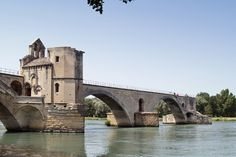 The Pont Saint-Benezet,also known as the Pont d'Avignon,spans the Rhone.Before the heavy flooding of the Rhône prevailed,the bridge had 22 arches,connecting the left bank of Avignon with Barthelasse island where there were many taverns in the nineteenth century.This is probably where they danced as the famous nursery rhyme says.