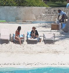 Having a chat: Beatrice was then spotted relaxing on a sun lounger beside a friend, 20 May 2015.