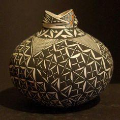 Shauna Rustin |   Pueblo:  Acoma.  Black on white fine line designs, light as a feather