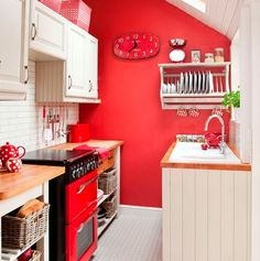 From Ideal homes...I am thinking of painting the under stairs cupboard, larder and laundry room in bright or fresh solid colours,and keeping the kitchen white and cream. So you would have a blast of colour every time you opened a door.