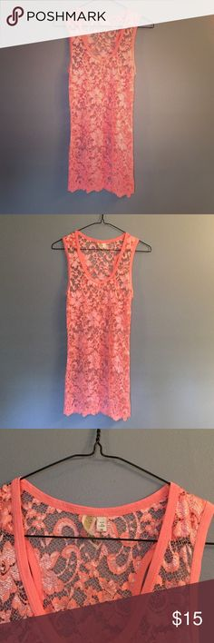 Lacy orange Daytrip top size M from the Buckle. Cute lacy orange top. The lace is stretchy and makes to top very comfy to wear!  Size medium but fits more like size small. Daytrip Tops Tank Tops