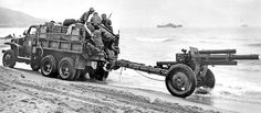 The standard prime mover for the 105mm Howitzer M2A1 was the 2 1 / 2 -ton truck, usually the GMC short-wheelbase CCKW-352, like the one seen here during the Operation Torch landings in North Africa in November 1942.