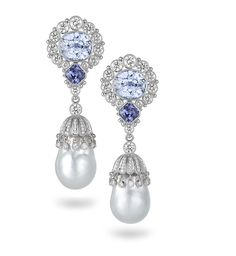 Stunning blue sapphires meld with diamonds and white South Sea pearls in Deirdre Featherstone's platinum earrings. Wow!