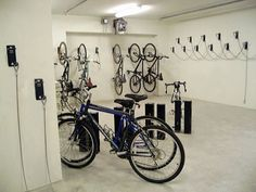 Commercial bike storage. Hanging and upright storage options.  Also appears to have a cable locking system integrated.