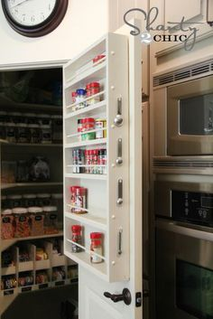 The pull-out spice rack from Bed, Bath & Beyond with DIY labels organizes my cabinet and allows ...