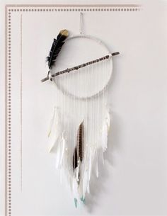 unique modern dream catcher with feathers and straight lines