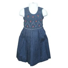 """Jemma (Navy) - Traditional smocked dress with embroidery overlay.  Sleeveless style.  Button fastening of the  straps and back, with matching fabric """"ribbons"""" to tie a bow. Available in sizes 6 months - 6 years."""