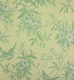 Chelsea Morning Toile Wallpaper A toile wallpaper featuring birds amongst flowering branches in green on yellow.
