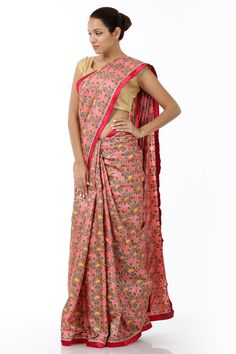 Featuring a beautiful interplay of colours and patterns this designer sari is fashioned in kosa silk fabric with a delectable pink colour tone. It is designed with a contrasting border and is further accentuated with a heavy dose of intricate floral patterns cascading the silhouette. This piece comes with a complimenting blouse piece.