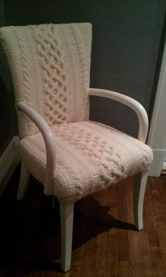 Formerly ugly chair made nice again with a custom-knitted upholstery job.