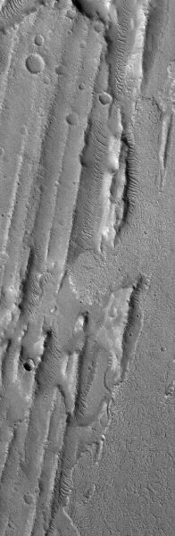 Kasei Valles Flows October 26, 2013 This Mars Global Surveyor (MGS) Mars Orbiter Camera (MOC) image shows flow materials—on the east/right side of the image—that have come in among a suite of sharp ridges and grooves on the floor of the vast Kasei Valles system. The ridges and grooves are much older and are believed to be the result of a giant, catastrophic flood.