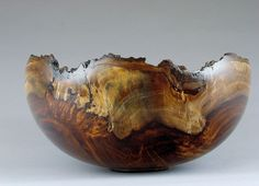 """David Linden - """"Fire and Smoke"""" West Indian Rosewood This is a beautiful natural edge bowl! 'Like' us at www.facebook.com/NOVAwoodworking and share your woodturning bowls with us! We would love to see what you have created"""