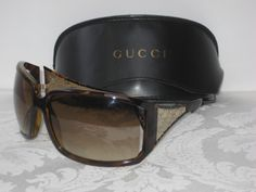 05cfcbce0ba Gucci sunglasses. Multi brown tortoise frames with brown lens. Features  silver GG cutout detail