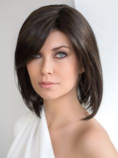 Icone Wig by Ellen Wille Icone by Ellen Wille is the perfectly tailored long bob style. This iconic style falls right above the shoulders and has fringe that side sweeps with ease at cheek bone level. The transitional layers are placed so that you may comb it under or flipped out. The ear-to-ear extended lace front offers versatile styling and the most seamless, natural appearance. The premium synthetic fiber used to create the Ellen Wille Icone mimics the look, feel and movement of…