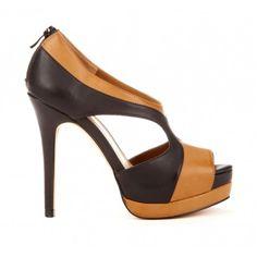 Colorblock platform sandal with back zip. Features double platform.