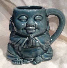 MEDITATING BUDDHA COFFEE CUP IN TURQUOISE GLAZE MADE BY MERITAGE EXC COND