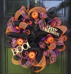 Deco mesh wreath. I must make one with Christmas colors!