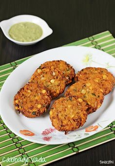 Cabbage vada recipe made with chana dal. Crisp fried vada made with chana dal and cabbage. These are a tea time snack made similar to masala vada recipe