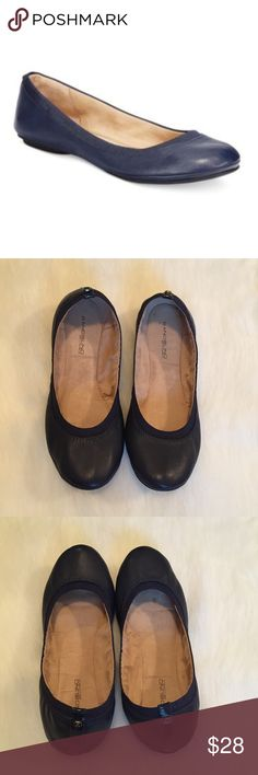 Bandolino Edition Ballet Flat in Navy Leather Everyone needs a pair of ballet flats in her shoe closet, and this pair from Bandolino is perfect! Navy leather upper with elastic around top of shoe. In excellent condition with no visible damage. The only sign of wear is a tiny dot inside the shoe. Worn once before I realized they were the wrong size. Please ask questions before purchase as all sales are final. Bandolino Shoes Flats & Loafers