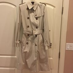 Authentic Burberry Trench Authentic Burberry Ivybridge Trench in excellent condition. Size 6R, but could definitely work for a 4 as well! Nova check lining. Worn twice! Comes with Burberry hanger and Burberry garment bag. Cotton poly blend. Leather accents at cuffs and belt. Gorgeous piece. Price dropped and now firm! Excluded from bundle discount. Burberry Jackets & Coats Trench Coats