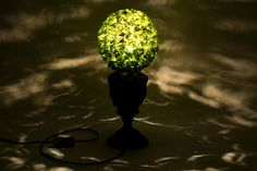 Buxus bush on a classic lamp stand.