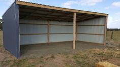 Our double horse shelters designed and built by my very talented husband. Still to have internal wall lining.