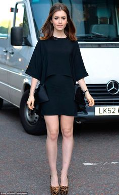 Lily Collins stylish in a black minidress and leopard print stilettos as she arrived at the ITV studios on Monday
