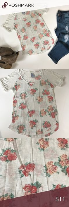 Nollie white floral scoop neck short sleeve top A Nollie short sleeve scoop neckline top. The top is from Pacsun. The top is in great condition. The main color is white making the shirt a little see through. The floral pattern is red, cream, and mauve. The floral pattern does not extend onto the sleeves. The sleeves roll at the end. Armpit to armpit is 16 inches. Top to bottom is 25 inches. PacSun Tops Tees - Short Sleeve