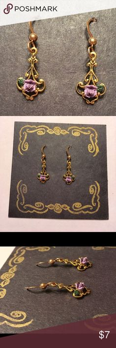 Gold dangly earrings with tiny purple roses 🌹 Gold dangly earrings with tiny purple roses 🌹 . NWOT. Always accepting offers!**remember with any new (or new to you at least) set of earrings to clean them in hydrogen peroxide 🙂 Jewelry Earrings