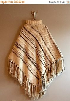 Wow! What a find! This poncho is in excellent condition and is so warm! The shoulders are 17 across so a little on the small size. Any bigger