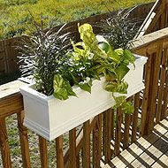 Check out https://www.flowerwindowboxes.com!  Deck rail planters, porch rail planters, and balcony planters are part of our product line at Flower Window Boxes. Our planters can attach over almost any railing or fence.  We can custom fabricate brackets for your deck or fence railing.  Each of our deck railing window boxes is supported with a thick, steel deck railing bracket. Our deck railing flower boxes are available in custom lengths and many styles.