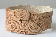 Polymer clay bangle/cuff bracelet by Anke H. aka Anart Island Studios. What a cool faux bone or ivory piece.
