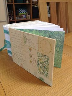 Stitched spine family tree book with embroidery on the pages of the book and pockets to hold papers and documents