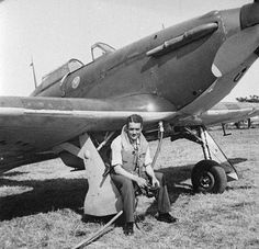 "P/O Jan EL ""Johnny"" Zumbach of No 303 Squadron RAF is placed on standby at RAF Northolt in 1940, with the start charger plugged into Hurricane Mk I RF-U. The aircraft was flown by Sgt Josef František on 9 September during action with enemy fighters over Beachy Head after which he crash-landed in a cabbage field at Cambridgeshire Farm, Falmer, shortly after 18.00. During the day, the 25-year-old Czech was credited with an Me 109 and a He 111 destroyed over the Sussex coast."