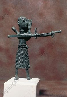 Archer wearing an oriental style skirt, bronze statue, height 15.5 cm, from the village of Sa Costa, Sardara, Sardinia, Italy. Nuragic civilisation, 5th–8th century BC. Cagliari, Museo Archeologico Nazionale (Archaeological Museum)