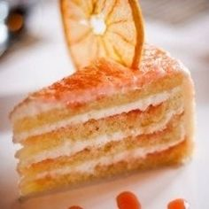 Grapefruit Cake by magicalrecipes: A light, genoise-style cake layered with flavored cream cheese and fresh grapefruit as served at Hollywood Brown Derby at Disney World #CAke #Grapefruit