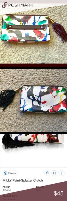 MILLY paint-splatter clutch with tassel A vibrant paint-splatter motif brightens up this slim design styled with radiant hardware and a tassel-trimmed zipper. Top zip closure. Two inside pockets for cards/cash & one zipper pocket. Strap on back makes it easy to clutch. Great condition- only a couple light makeup marks on the interior. Milly Bags Clutches & Wristlets