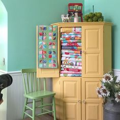 Love the hutch with quilts - charming!