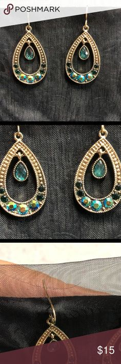 Ladies Earrings These earrings are gold in color and are adorned with the color of peacock feathers! The stones seem to change color as you move the earrings. The center stone is a beautiful turquoise color and dangles on its own. These are not heavy earrings, but they are not super light either. They are on wire backs but do have a small back on them. These are BRAND NEW earrings. Jewelry Earrings