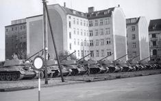 Aug. 1961: East German tanks assemble in front of the Friedrichstrasse train station with their guns pointed west.