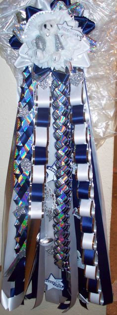 My best friend makes the BEST homecoming mums and garters...check her out!    Single Homecoming Mum  www.dkmums.com