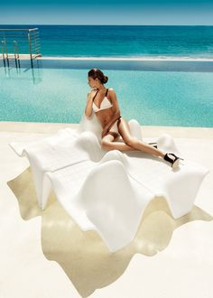 Italian designer Fabio Novembre has introduced a sleek new collection of outdoor furniture for Vondom called F3 (F3 = Form Follows Function). The curvy pieces are based on mathematical surfaces that flow from one piece to another when placed together.