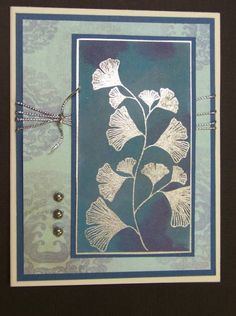 handmade card for F4A82 QFTD78 Mostly Blue by hobbydujour  ... Asian look .. silver embossed gingko leaves ... soft dusty blues and aqua ... luv the silver embellishment s ...