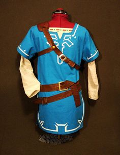 If you are going to cosplay Link or just looking for a good costume, here I am to offer you one. This costume is made of good quality textile and all the ornaments are painted with acrylic dye. The armor is made of eva-foam. Full costume includes: Blue tunic Pants Painted cape Belts Painted parts of sleeves Arm bracer You can also order just one tunic with painted sleeves! And I also have Links shield, bow and Sheikah slate! !Shipping details! Usually it takes the parcel about 3-6 weeks ...
