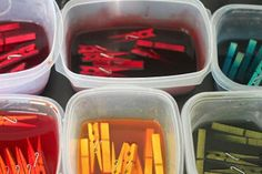 Color clothes pins by soaking in food coloring. In each jar or container, pour boiling water, a tablespoon of vinegar and food coloring drops and mix well.  You can use any combination of drops to make varying colors and shades.  I used both traditional food colors and the neon food colors to make about a dozen different colors.  Add your clothespins and let them soak for at least an hour.
