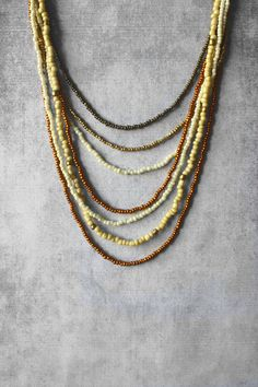 Layered necklace bronze beaded necklace gold by AnankeJewelry