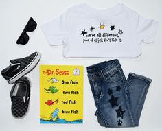 "Our, ""Different Stars"" tee, is paired with #Viggos jeans (found at #Nordstrom), # vans slip-ons, black sunglasses from #carters, and the classic #Dr.Seuss book, ""One Fish, Two Fish, Red Fish, Blue Fish"".   #peculiarlyperfectclothing #peculiarlyperfect #kidsclothing #kidsfashion #flatlays #differentstars #stars #specialneedskids #allkids"